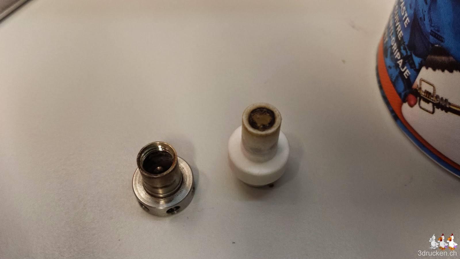 Foto eines angesengten Isolators und eines verunreinigten Metallteils